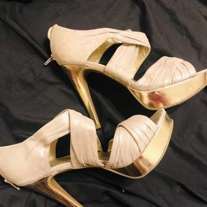Guess 6 inch heels. Gold. Used but in great shape